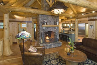 Peeled bark timberframe interior provides warmth and beauty