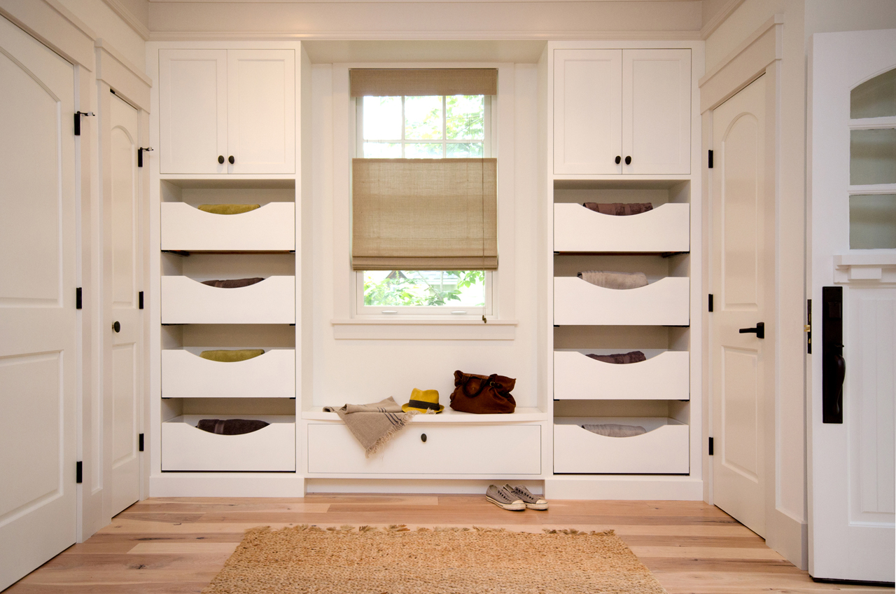 A custom closet adds a contemporary flair.
